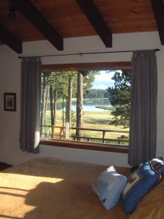 Wake up with a view of the mountains and lake