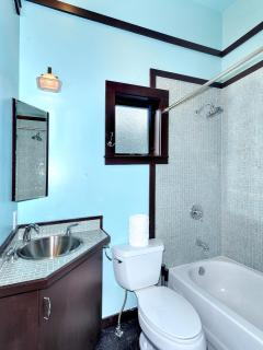 Bathroom with hair dryer and fluffy white towels