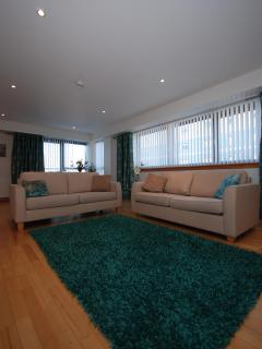 Two comfortable sofas in our modern, stylish lounge