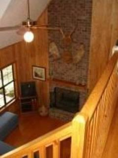 Looking from the second floor onto the first floor living room and fireplace