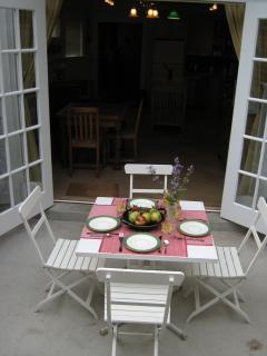 Patio with table and chairs/ umbrella provided