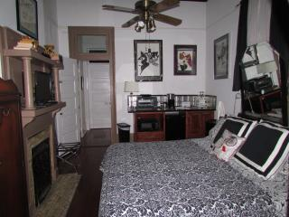 The bedroom features a king-size bed and a sideboard with microwave oven, toaster oven, & coffee pot