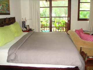 The spacious Master bedroom equipped with a King size bed, sofa, flat screen tv.