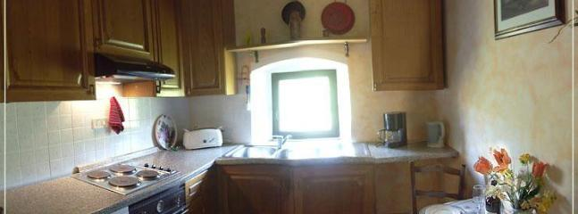small, but fully-equipped kitchen with dining area