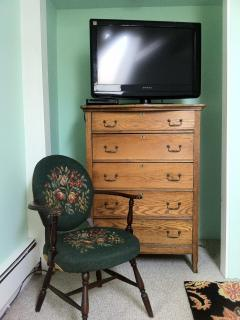 Flat Screen TV and Luxurious Antiques In The Bedroom