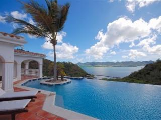 Beautiful Alizés enjoys a stunning view over the water of Simpson Bay lagoon and the Caribbean in the distance., Terres Basses