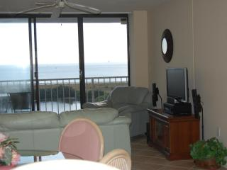 Livng room with view of Gulf of Mexico. Has flat screen TV and stereo.