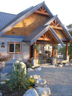 This is our home that sits on the same one acre property at Blue Orca Cottage