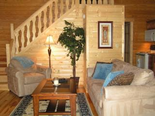 Living room with stairs to the loft