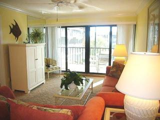 Living Room Has 42' LCD-HD TV, sofa and love seat and opens onto screened lanai