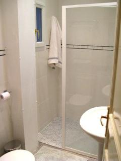 Double-Size Walk-In Shower, Italian Tiles, Lighted Vanity Complete the Spa-Like Atmosphere