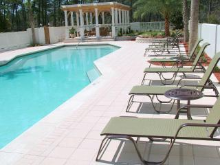 Pool chairs and Gazebo in background