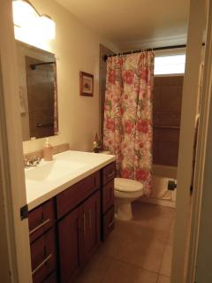 Remodeled bathroom with tub.