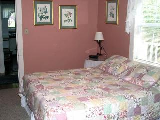 The Queen bedroom features an adjoining bathroom and plenty of southern charm.
