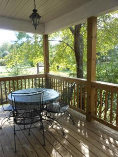 The porch is the place for a picnic in the summer and overlooks some of our park-like 26 acres.