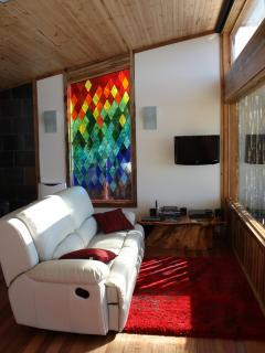 Relax in the reclining leather lounge while watching the changing weather across SE Tasmania