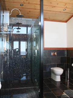 Unwind in double granite shower, watch the view change at the same time