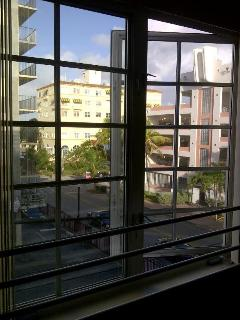 3 large windows that open to city