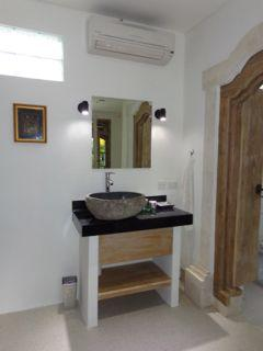 Vanity with perfect lighting to see by. AC above vanity unit