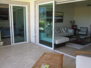 View of the condo from balcony - sliding glass doors into living room area and into Master bedroom