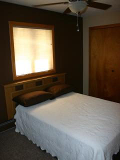 Brown Bedroom offers remote control cable TV, ceiling fan, clock radio and reading lamp