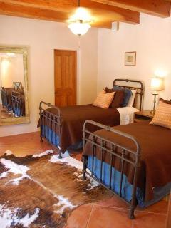 Casita twin bedroom (Bdrm 5). Bathroom with tub and shower is in this room.