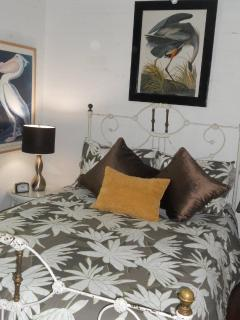 double bedroom with antique iron bed