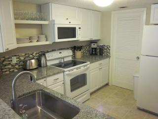 Fully equipped renovated kitchen with new appliances and granite counter.
