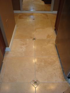 Imported travertine tile floor with insets