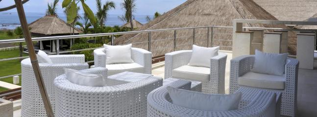 Sunset deck with terrace, lounge and cocktail bar overlooking garden and Bali Sea (2nd floor)