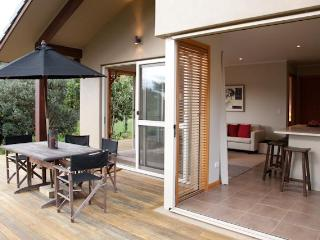 lounge and kitchen opens onto expansive decks