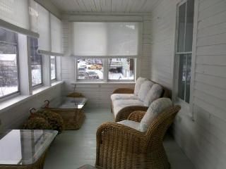 Three Season enclosed porch - great place to read a book!