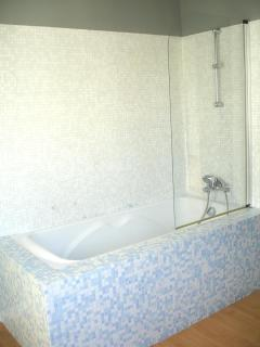 Bathtub and shower with mosaic marble tiles