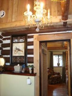 King Suite Private Bath has log walls, cathedral ceiling and a crystal chandelier!