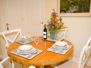 Coordinated dinnerware, welcome flowers and wine, original artwork. Extra table leaves available.