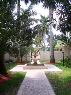 Courtyard walkway to stairs or elevator to condo