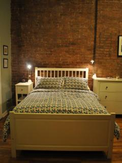 Full-size bed with reading lights.