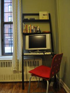 Desk with TV/Monitor. Full cable service and Mac Mini included. Also Wi-Fi.