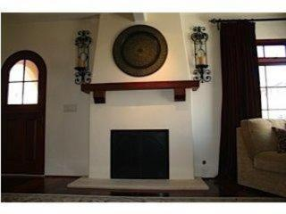Designer decorated living room with a warm and cozy gas fireplace.