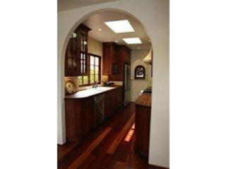 Gourmet kitchen with stainless steel appliances and butcher block countertops.
