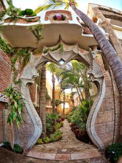 Entry to the 'Mask Garden' path leads to the pool area and beach.