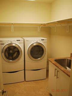 Large laundry room with utility sink
