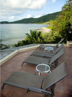 View of Nail Bay and Long Bay from the Sunset Watch Villa poolside terrace.
