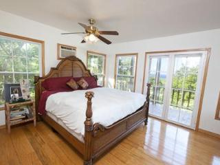 Master Bedroom w/hardwood floors, ensuite, aircon, french doors to private deck