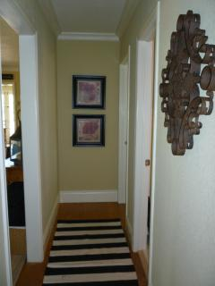Hallway off living room to bedrooms and bathroom.
