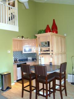 Kitchen has stovetop and toaster oven, full fridge/freezer, blender, waffle maker, slow cooker