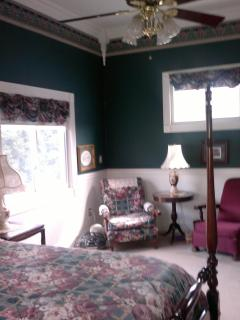 guest suite/king bed/sitting area/$230/night