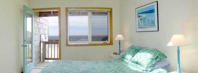 The first floor master bedroom with king bed. Beautiful ocean views from a private balcony.