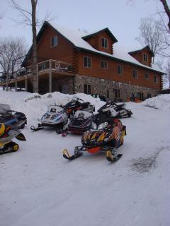 Log retreat with snowmobiles