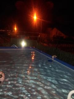 Night View of Pool with Aqaba lit up
